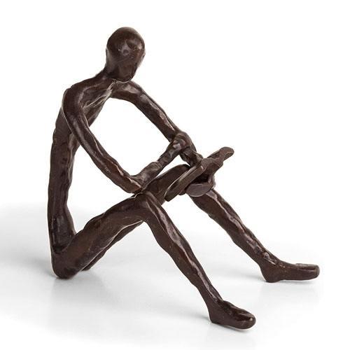 bronze man reading sculpture